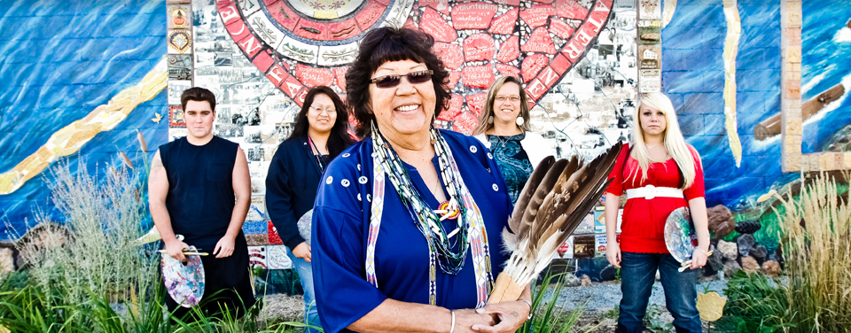 What was a blank wall Laurie Tenpas, second from right, saw as a huge canvas. She brought together residents like Nettie Kingsley, center, and  others to create the Swiftwater Mural celebrating Nekoosa's heritage and culture.