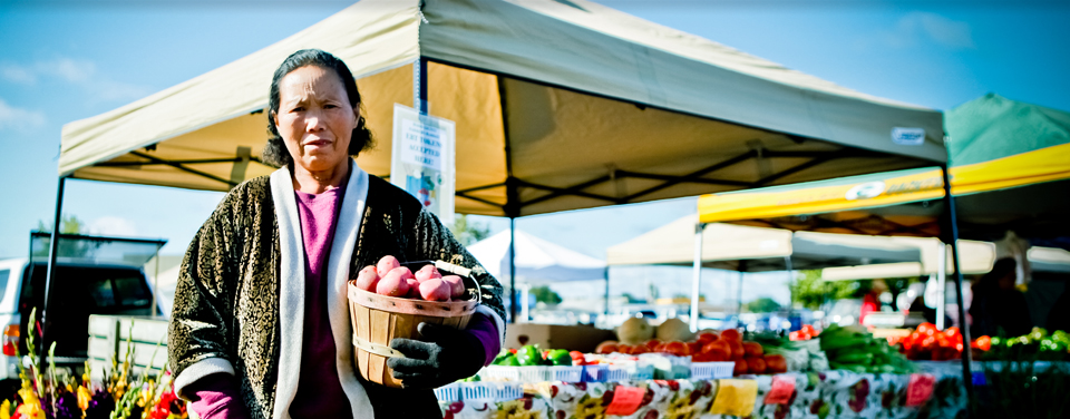 Soua Vue's farmer's market stand welcomes Food Share credits, so low income residents can choose to make fresh fruits and vegetables part of their diet.